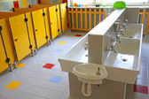 Small bathrooms and low sinks in a school for young children — Stock Photo