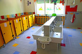 Small bathrooms and sinks in a school for young children — Stock Photo