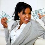 Afro-american girl holding plenty of cash money — Stock Photo #11763280