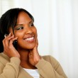 Fresh woman smiling and conversing on mobile — Stock Photo