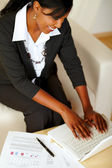 Attractive businesswoman working on laptop — Stock Photo