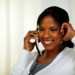 Relaxed young black woman speaking on phone — Stock Photo