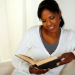 Young pretty woman browsing a book — Stock Photo #12332812