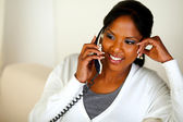 Afro-american female conversing on phone — Stock Photo