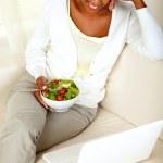 Adult black woman eating healthy green salad — Stock Photo