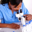 Dedicated scientific woman working at laboratory — Stock Photo #12673723