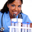 Medical doctor woman looking at you - Stock Photo