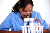 Charming scientific female using a microscope — Stock Photo