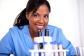 Scientific woman looking at you — Stock Photo