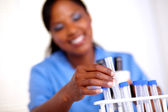 Scientific woman working with test tube — Stock Photo