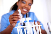 Scientific young woman working with test tube — Stock Photo