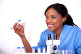 Smiling scientific woman working at laboratory — Stock Photo