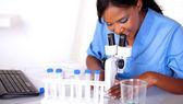 Scientific woman in blue uniform working — Stock Photo