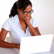 Charming young black woman working on laptop — Stock Photo