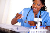 Beautiful nurse working with a test tube — Stock Photo