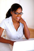 Young woman browsing the internet on laptop — Stock Photo