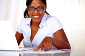 Afro-american girl with black glasses studying — Stock Photo