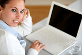 Young woman looking at you browsing the internet — Stock Photo