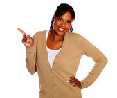 Charming young woman pointing right looking at you — Stock Photo