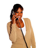 Adult woman speaking on phone — Stock Photo