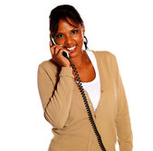 Young black woman talking on phone looking at you — Stock Photo