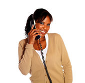Young black female talking on phone looking at you — Stock Photo
