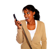 Surprised young woman looking to phone — Stock Photo