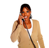 Charming female talking on phone looking at you — Stock Photo