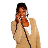Beauty young female smiling and speaking on phone — Stock Photo