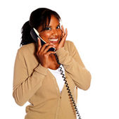 Happy young woman smiling and speaking on phone — Stockfoto