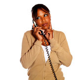 Pensive afro-american woman speaking on phone — Stock Photo