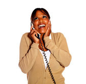 Happy surprised female conversing on phone — Stock Photo