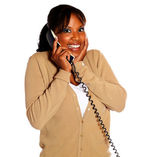 Happy young woman smiling and conversing on phone — Stock Photo