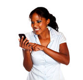 Young woman sending a message by cellphone — Stock Photo