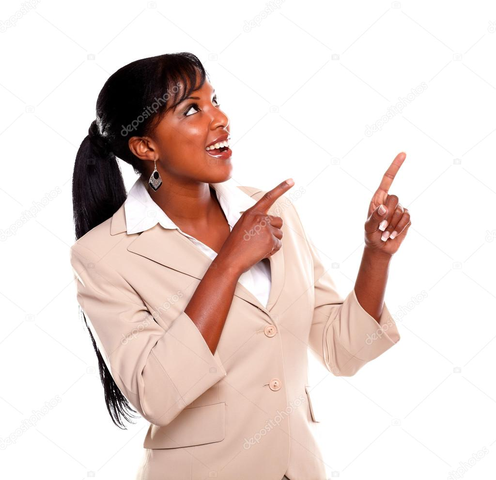 Young businesswoman looking and pointing up on isolated background — Stock Photo #13532427