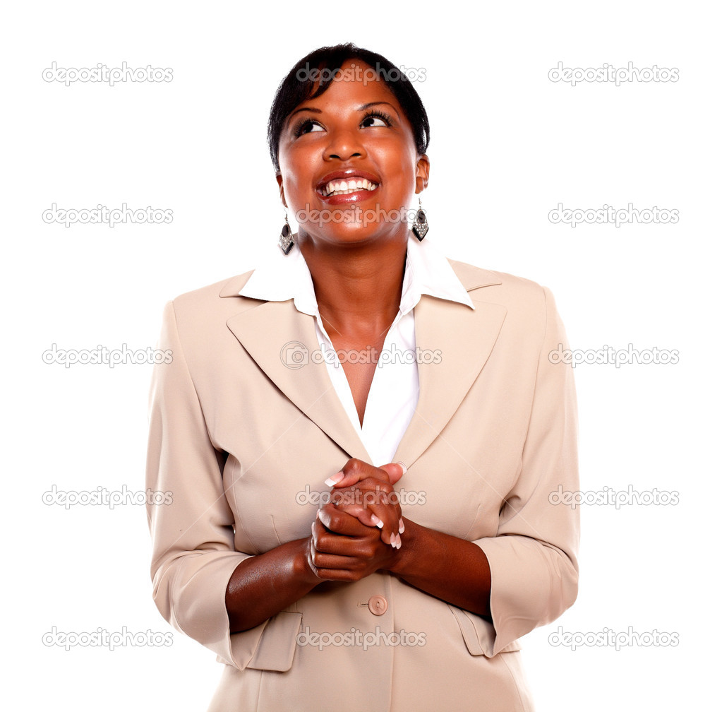Attractive executive woman smiling and looking up against white background — Stock Photo #13532459
