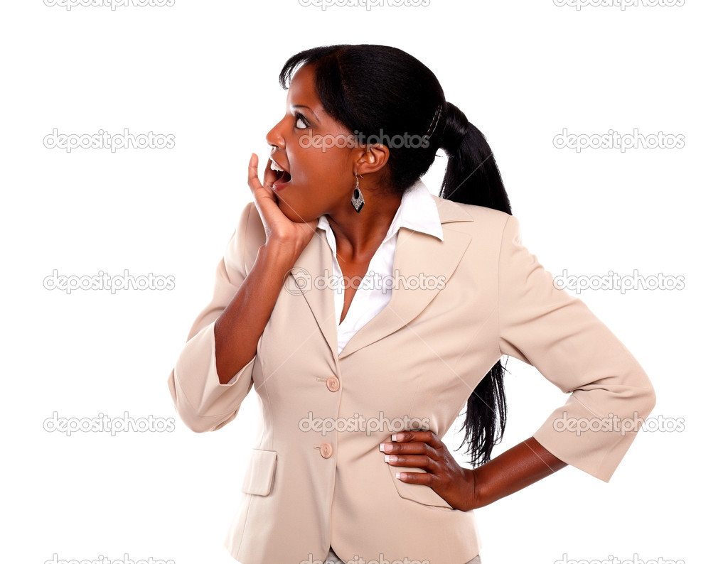 Surprised executive young lady looking right on isolated background  Stock Photo #13532464