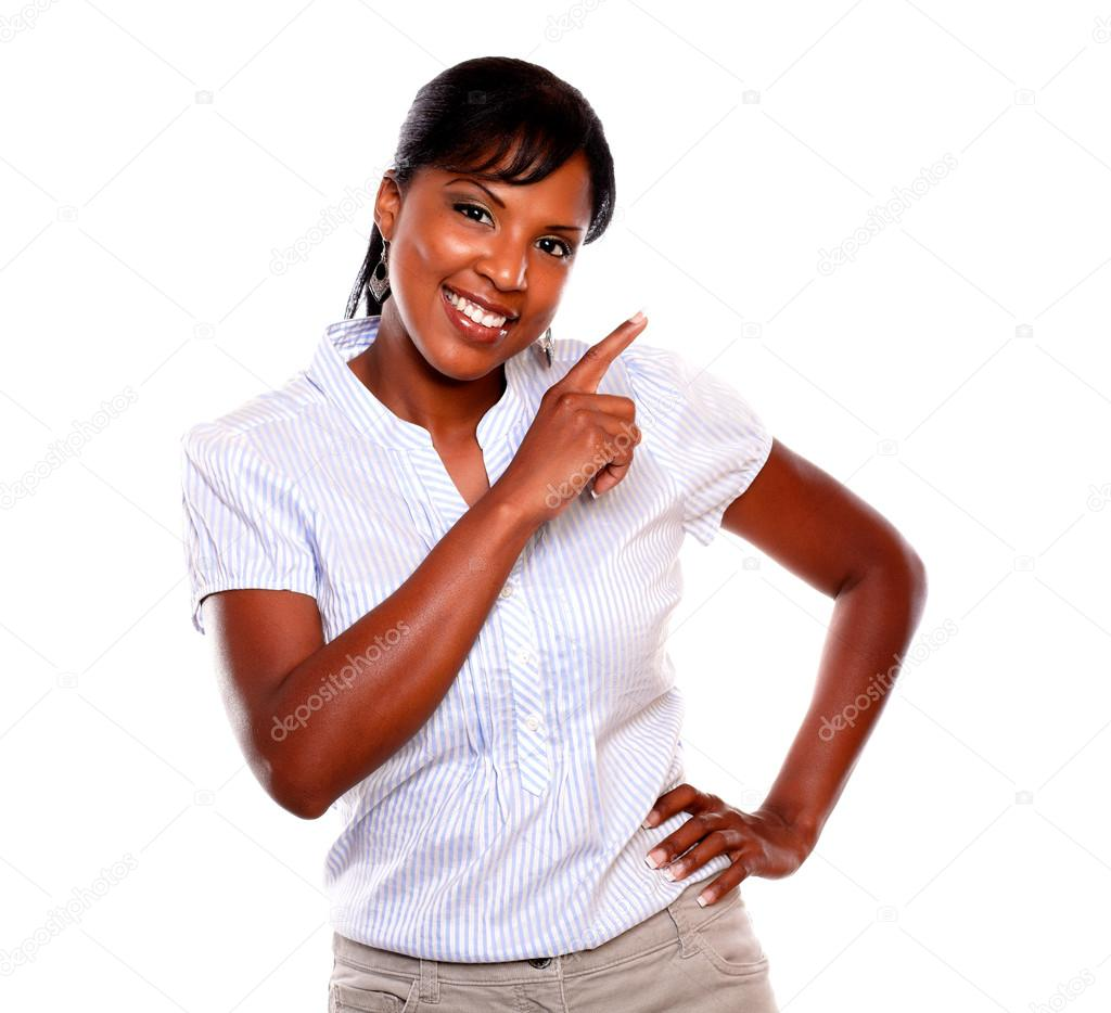 Smiling young woman pointing to her left white is looking at you on isolated background — Stock Photo #13738854