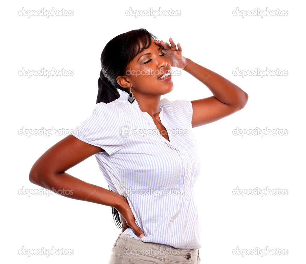 Stressed and tired young woman with headache against white background — Stock Photo #13738867