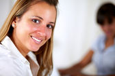 Positive young woman smiling looking at you — Stock Photo
