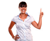 Friendly and smiling young woman pointing up — Stock Photo