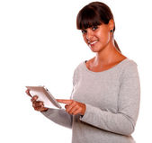 Smiling young female using her tablet pc — Stock Photo