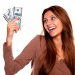 Stock Photo: Smiling young female holding up cash money