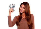 Charming and smiling young woman with cash money — Stock Photo