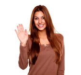 Young woman smiling and saying hello at you — Stock Photo
