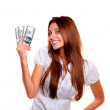 Happy young woman holding up cash money — Stock Photo
