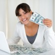 Smiling young woman showing you cash money — Stock Photo