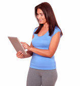 Sporty mature woman using her tablet pc — Stock Photo