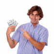 Charming msmiling and pointing to cash dollars. — Stock Photo #28732509
