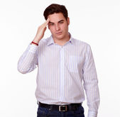 Young caucasian man with headache standing — 图库照片